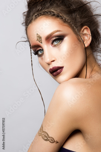 Glamour portrait of beautiful girl model with makeup and romantic hairstyle Poster