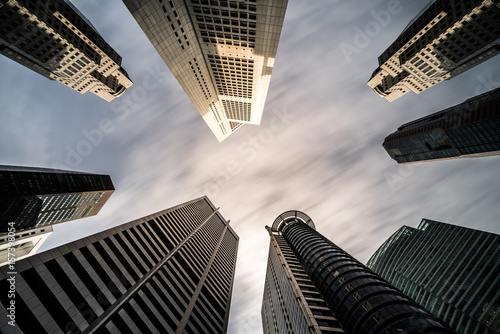 Business buildings skyline looking up with blue sky Poster