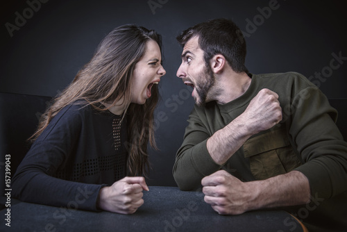 Young couple fighting fiercely, having relationship issues Poster