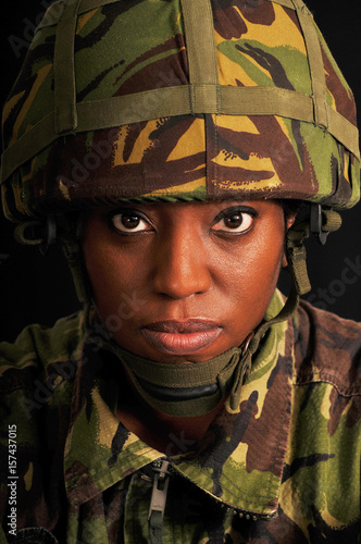 Portrait of female soldier wearing British military uniform. Poster