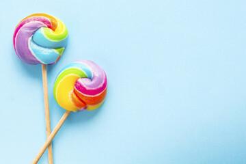two rainbow colour lollipop