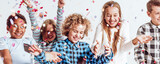 Smiling kids playing with confetti - Fine Art prints
