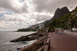 Leblon beatch deck on Rio de Janeiro with two brothers mountains on background