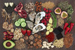 Aphrodisiac food to promote good sexual health on oak wood background.