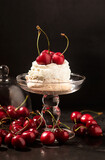 meringue with whipped cream and cherries