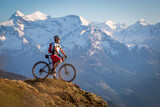 Male mountainbiker enjoying the view in the mountains
