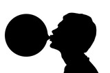 Silhouette of teenage boy blowing huge bubble