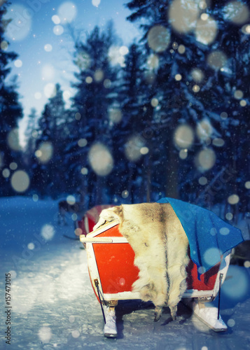Sledges at reindeer farm in Lapland Finland with night snowfall