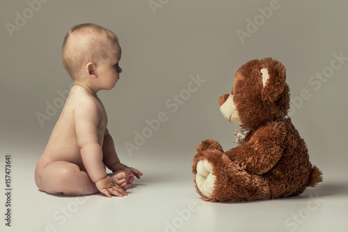 Little baby boy with teddy bear.