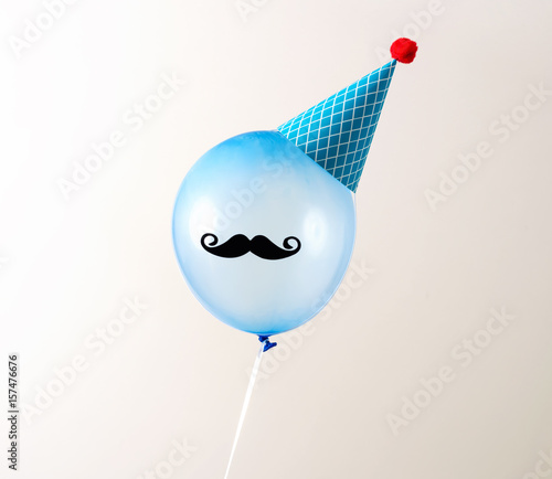 Balloon on an off white background