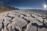 fisheye view of badwater with sun-bust sun