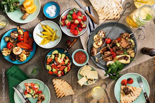 Shish kebab, various grilled vegetables, salad, lemonade, strawberries and snacks - 157489637
