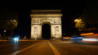 Night photo of iconic Arc de Triomphe in Champs Elysees, Paris, France