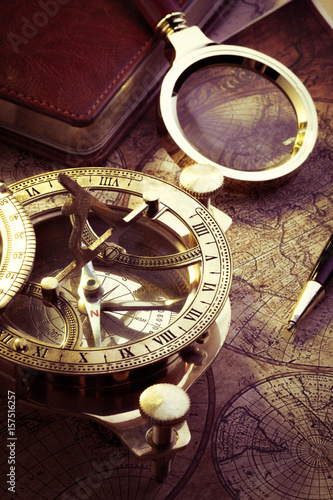 Plagát Old vintage compass and travel instruments on ancient map