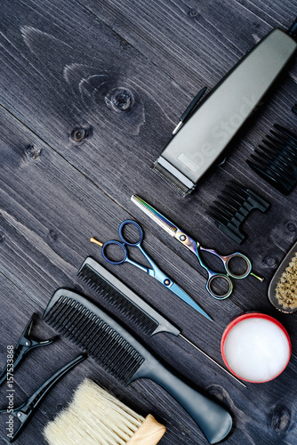 Hairdresser tools on wooden background Poster