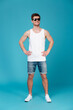 Full length portrait of a casual young man in sunglasses