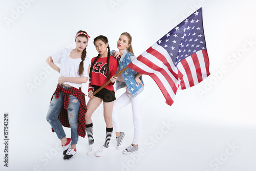 Poster stylish young women posing with american flag in hands isolated on white, Indepe
