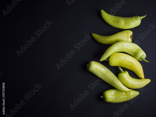 Papiers peints Hot chili Peppers Fresh light green and yellow chili peppers isolated on black background