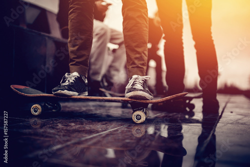 Skaters friends team outdoor in urban city with skateboards in their hands Poster
