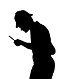 Silhouette of teenage boy investigating with a magnifying glass and Sherlock hat