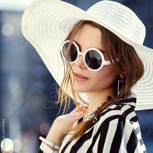 7e576c9e023 Outdoor close up portrait of young beautiful happy girl posing in street. Model  wearing stylish