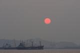 Cargo ship floating in the sea while the sunrise, Silhouette sunrise