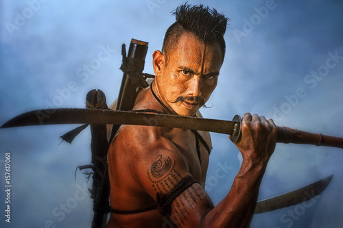 Ancient warrior man of soldier of Bang Rachan District Thailand hold sword fight,Images of dirty middle-aged fighters and swords Poster