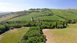 Amazing aerial view of Tuscany countryside winding road in spring season - Italy