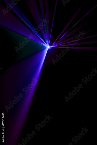 Laser beam purple on a black background - 157629433
