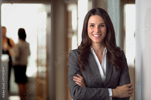 Leinwanddruck Bild Happy smiling ceo manager at office space, possibly real estate, lawyer, non-profit, marketing