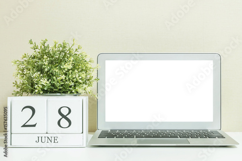 Poster White wooden calendar with black 28 june word with white blank space at center o