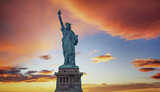 Statue of Liberty with orange sky in the background, New York City - 157641242