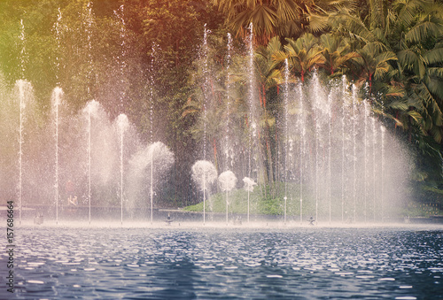 Fountain in KLCC Park in Kuala Lumpur on sunset. Malaysia Poster