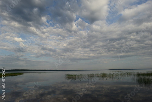 Morning calm on a lake with a mirror water surface