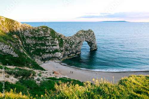 Beach, sea and Durdle Door on Jurassic Coast, Dorset, UK Poster