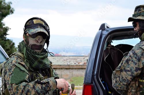 Foto op Plexiglas Kiev Soldier on hand smoke grenade headset communication disembark from car
