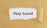 Text Stay tuned appearing behind ripped brown paper - 157809666