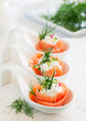 Appetizer of salted salmon and ricotta.