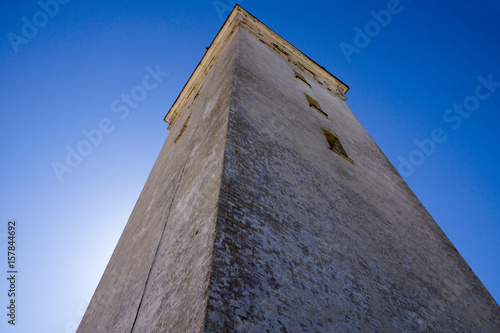 Lighthouse in the sand dunes of Rubjerg Knude in Denmark Poster
