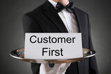 Waiter Holding Customer First Card On Tray - 157901815