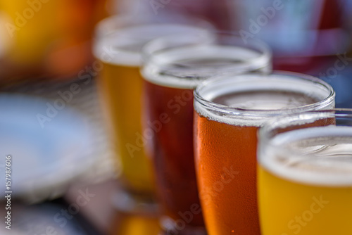 Fototapeta closeup of a beer flight sampler outside at microbrewery in summer sun