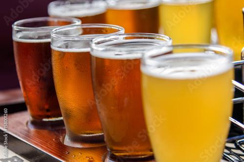 Fototapeta Closeup low angle view of beer flight