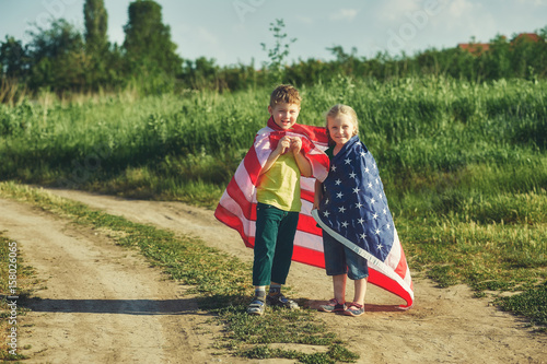 a truly Patriotic children with USA flag . The concept of independence day