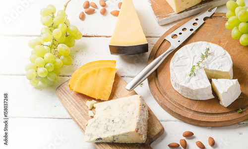 Different kinds of cheeses on a white wooden table © bit24