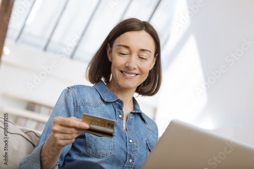 woman connected with laptop and shopping online Poster