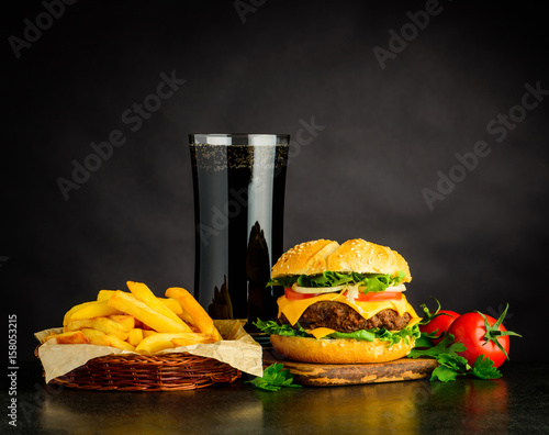 Tasty Looking Cheeseburger with Cola and French Fries Poster