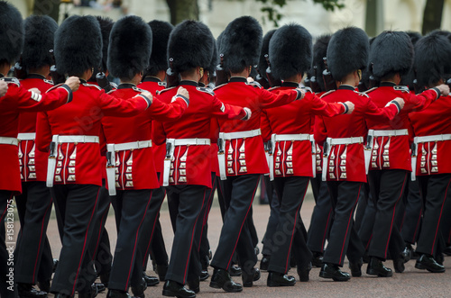Foto op Canvas Londen Soldiers in classic red coats march along The Mall in London, England in a grand Trooping the Colour spectacle of the Queen's Royal Guard