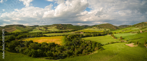 Beautiful Aerial landscape of waves hills in rural nature, Tuscany farmland, Italy, Europe