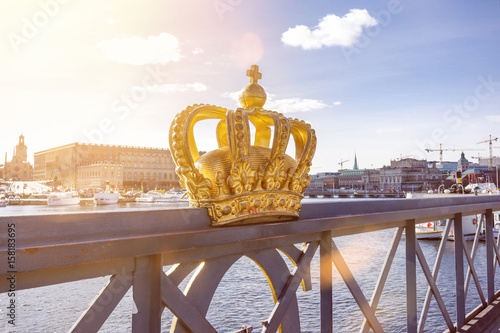 Skeppsholmsbron (Skeppsholm Bridge) with famous golden crown with royal palace i Poster