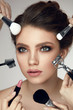 Beauty Cosmetics. Glamorous Woman With Makeup Brushes Near Face